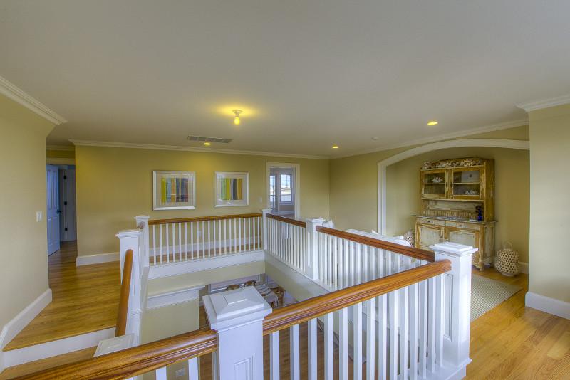 Hyannis wooden stairway banister